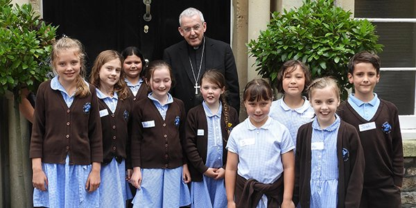 St Francis School prayer team grill Bishop Declan!